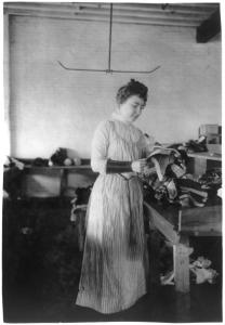 Woman_distributing_work_in_a_shoe_factory,_Lynn,_Mass
